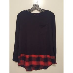 Oversized black knit sweater with plaid trim